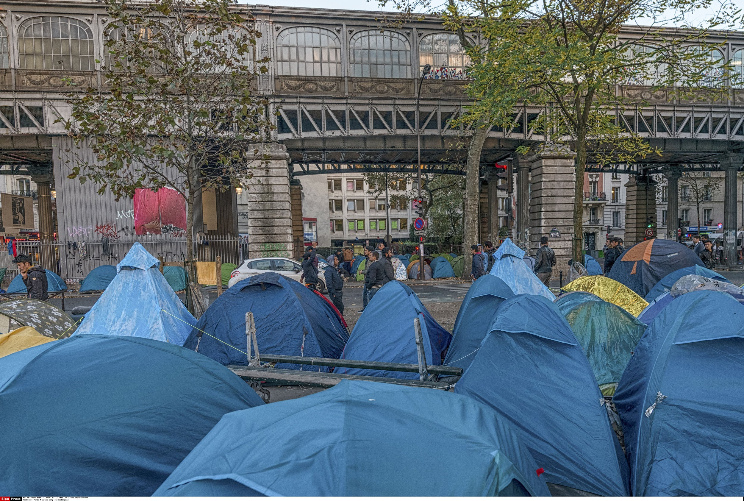 A team including two Harvard students has won first prize at Paris #Talents2024 for BubbleBox, a mobile hygiene unit that can be deployed to refugee camps such as this Afghan tent city in Stalingrad, Paris.
