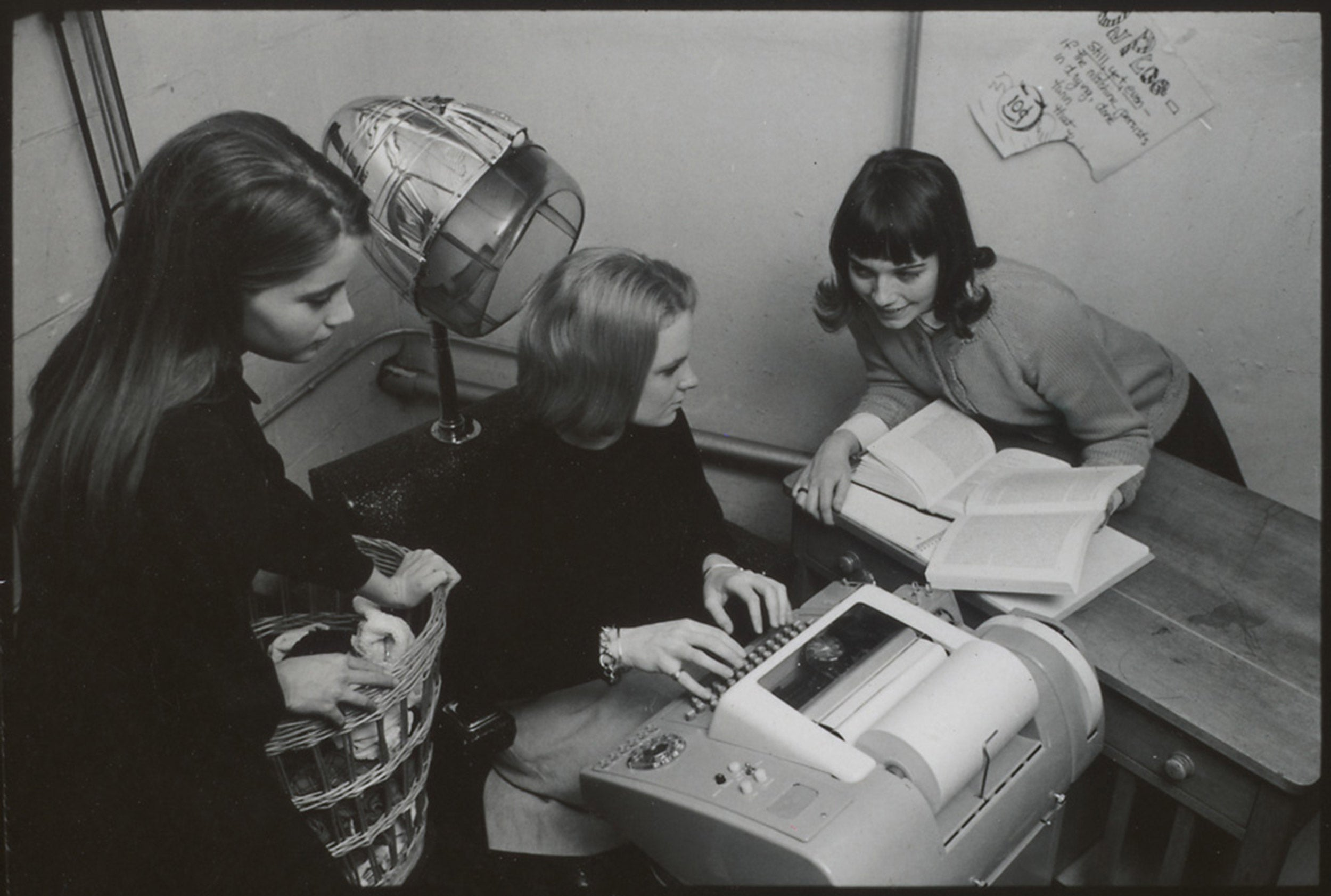 Radcliffe students circle a computer keyboard in basement of Cabot Hall, Feb. 8, 1966.