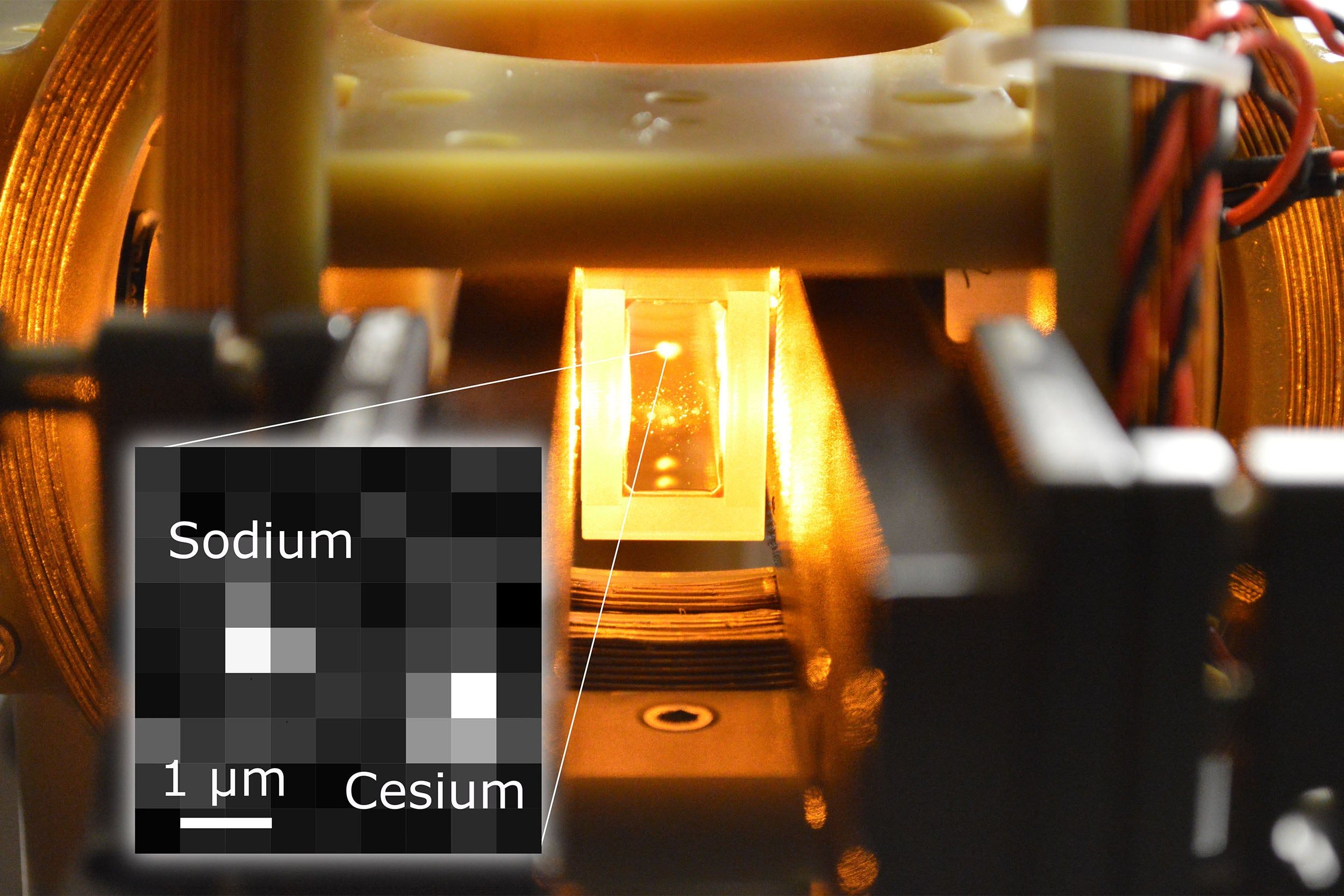 A single molecule has been produced in an optical tweezer by a controlled reaction between a single sodium and single cesium atom. Inside a glass cell vacuum apparatus, a laser-cooled cloud of sodium atoms is suspended, allowing a microscope to view the fluorescence from individual atoms trapped side-by-side.