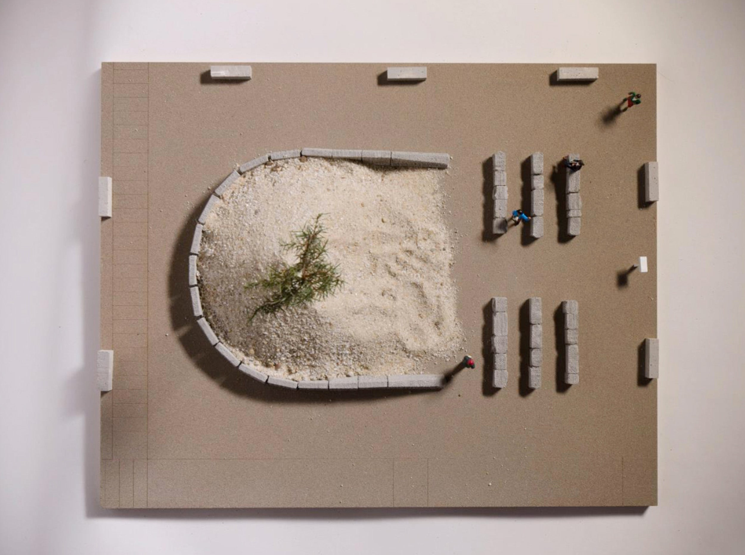 Rendering of design showing pine tree atop mound of sand.