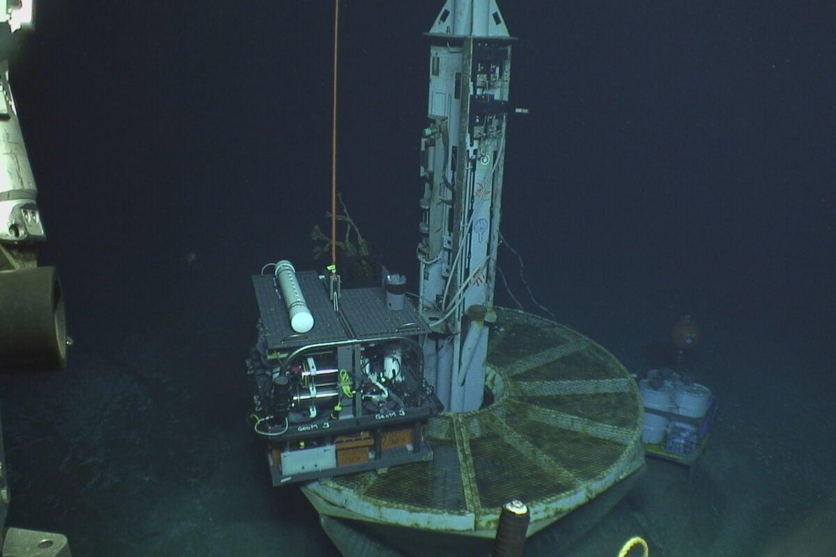 Researchers drill wells into the ocean floor.