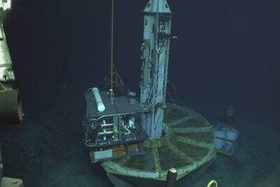 Researchers drill wells into the ocean floor.