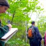 A student in the Extension School's Sustainability Program takes notes during a tour of Harvard Forest in Petersham, Mass. The program has seen rapid growth in the last decade as climate change becomes a greater threat.