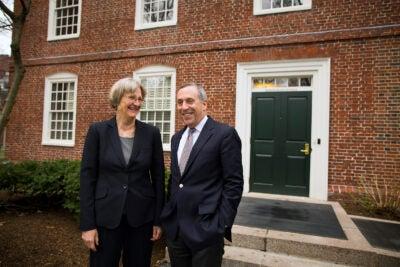 Harvard President Drew Faust (left) and Harvard President-elect Lawrence Bacow speak outside of Massachusetts Hall at Harvard University.