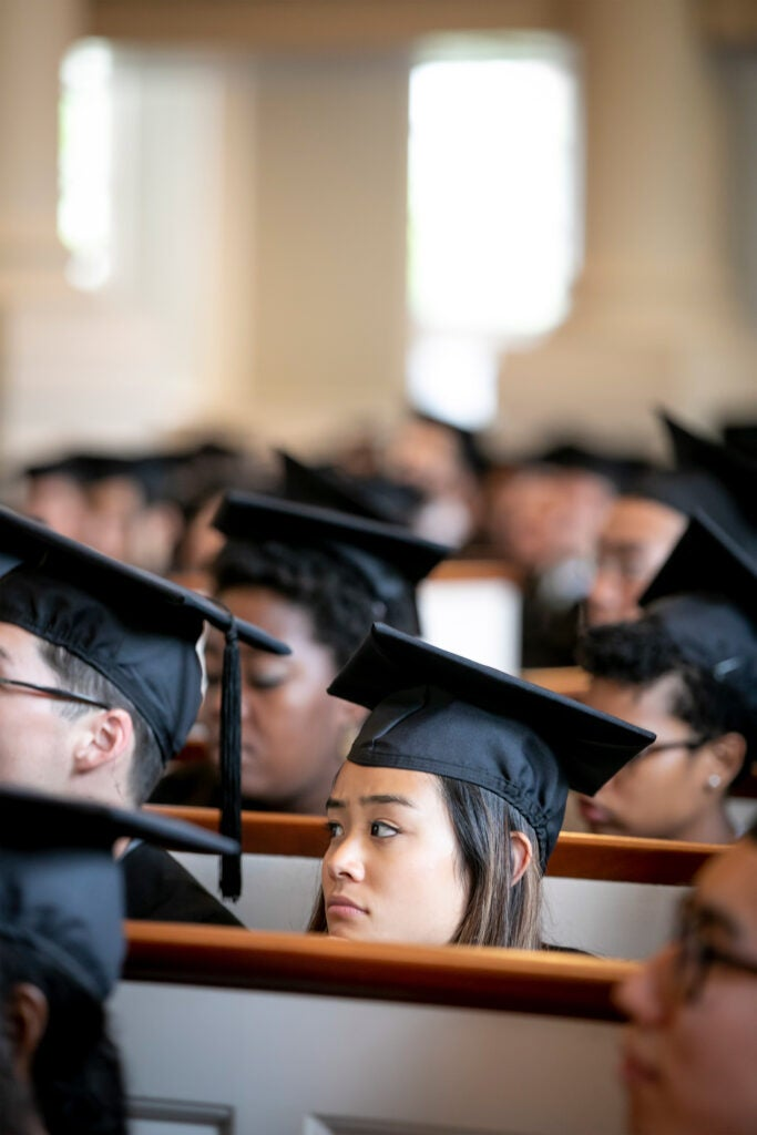 Close-up of student faces during baccalaureate service.