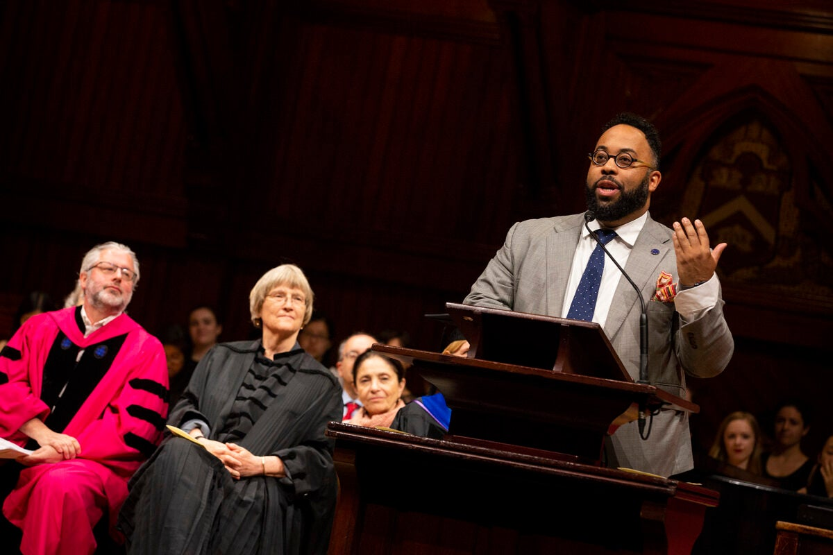 Neil Shubin, Ph.D. '87, (from left) and Harvard President Drew Faust listen to poet Kevin Young '92 recite poetry from his latest book during Phi Beta Kappa Literary Exercises for the Class of 2018.