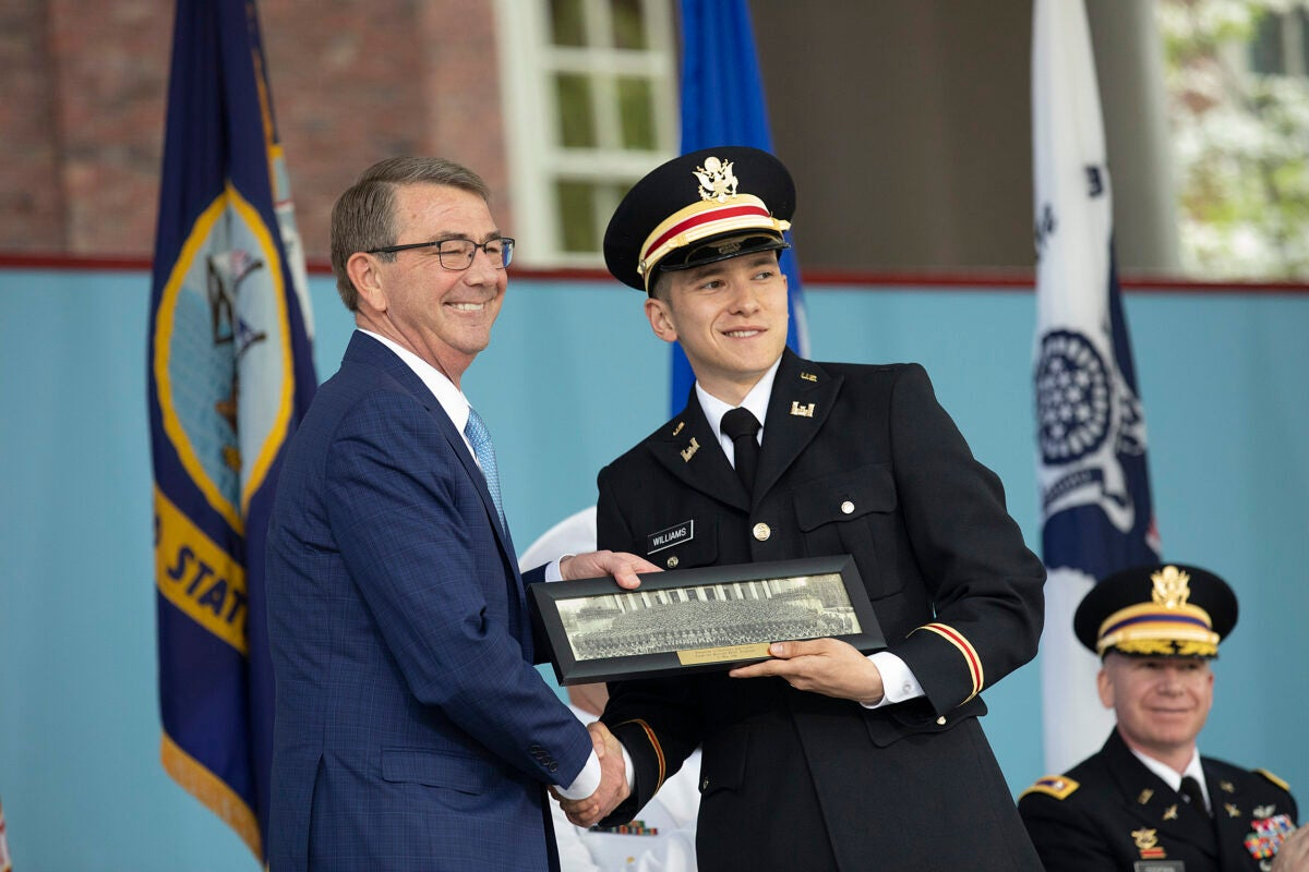 Belfer Center director Ash Carter congratulates Nathan Williams '18 during the ROTC Commissioning Ceremony during 367th Harvard Commencement.