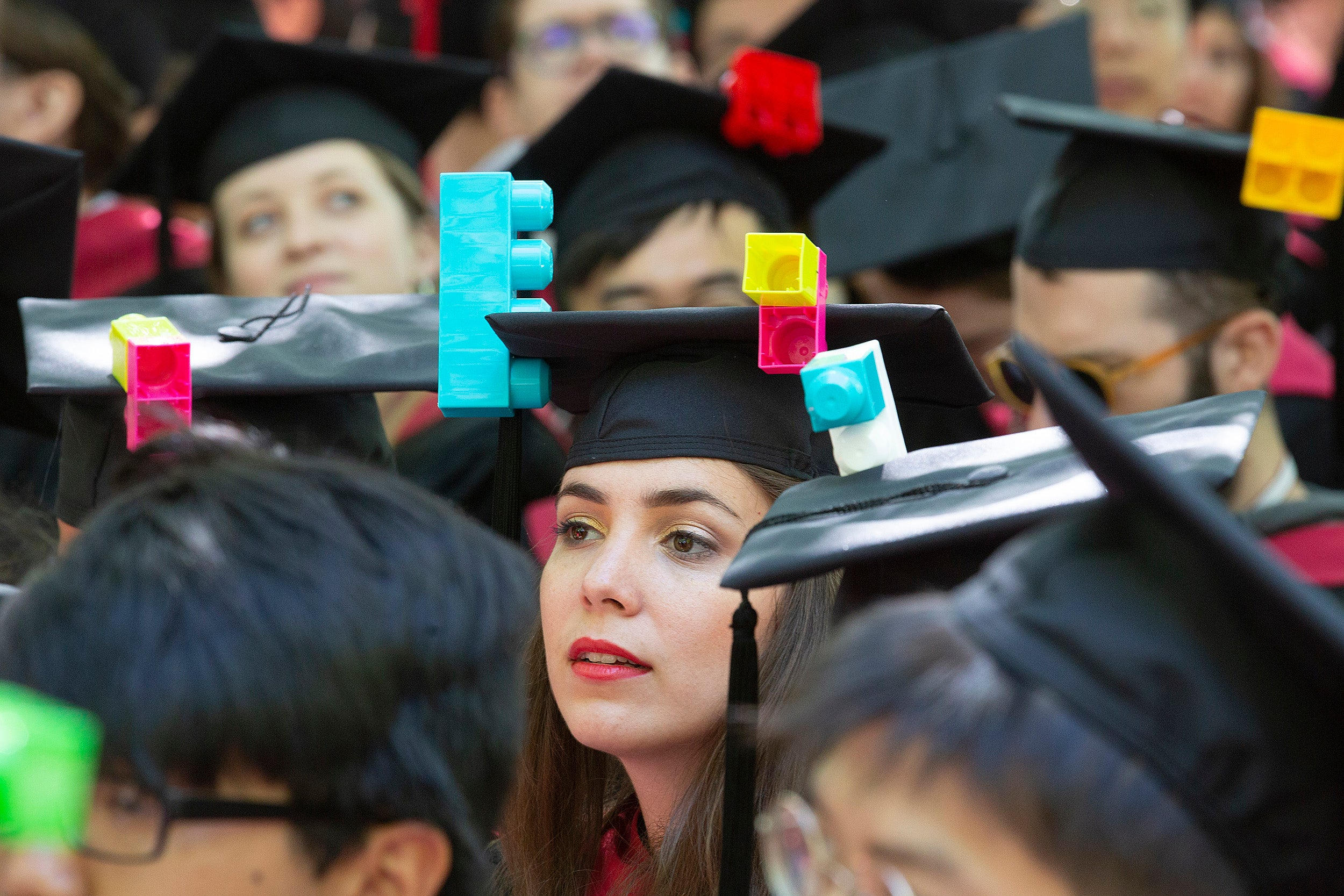 Graduate with Lego mortarboard.