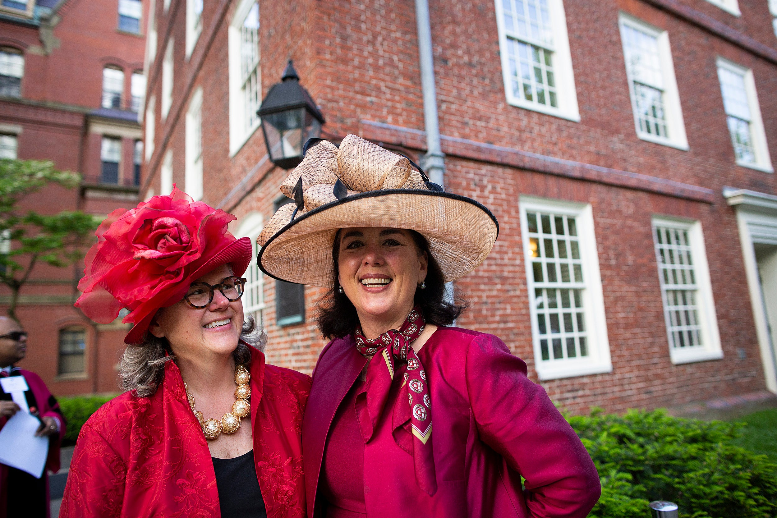 Katie Tiger and Trearty Bartley wear fancy hats at commencement.