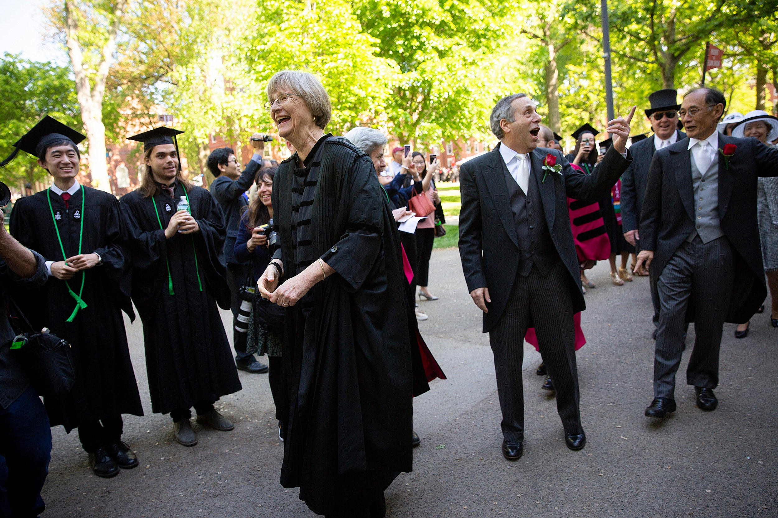 Drew Faust and Larry Bacow during commencement.