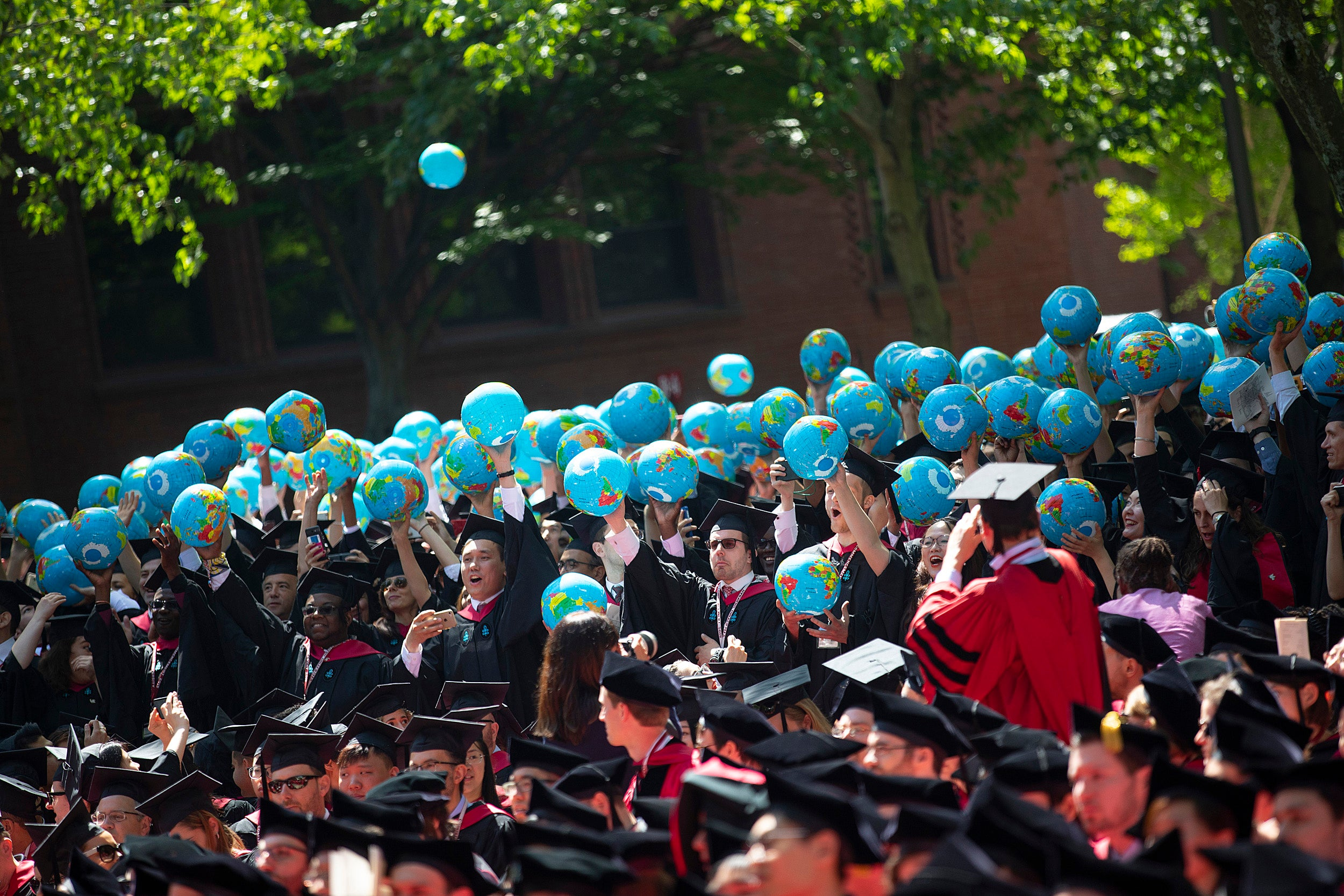 Graduates let inflatable globes loose.