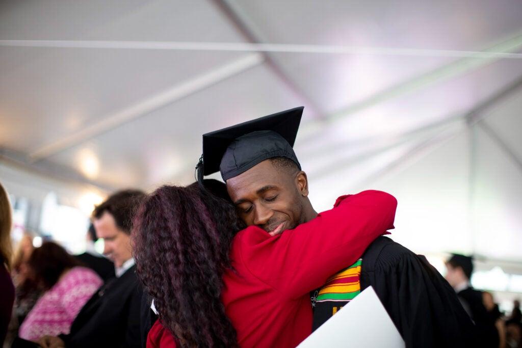 Razaak Eniola, Jr. hugs his mother