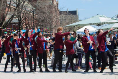The Harvard University Band gathers on the Science Center Plaza for the opening concert.