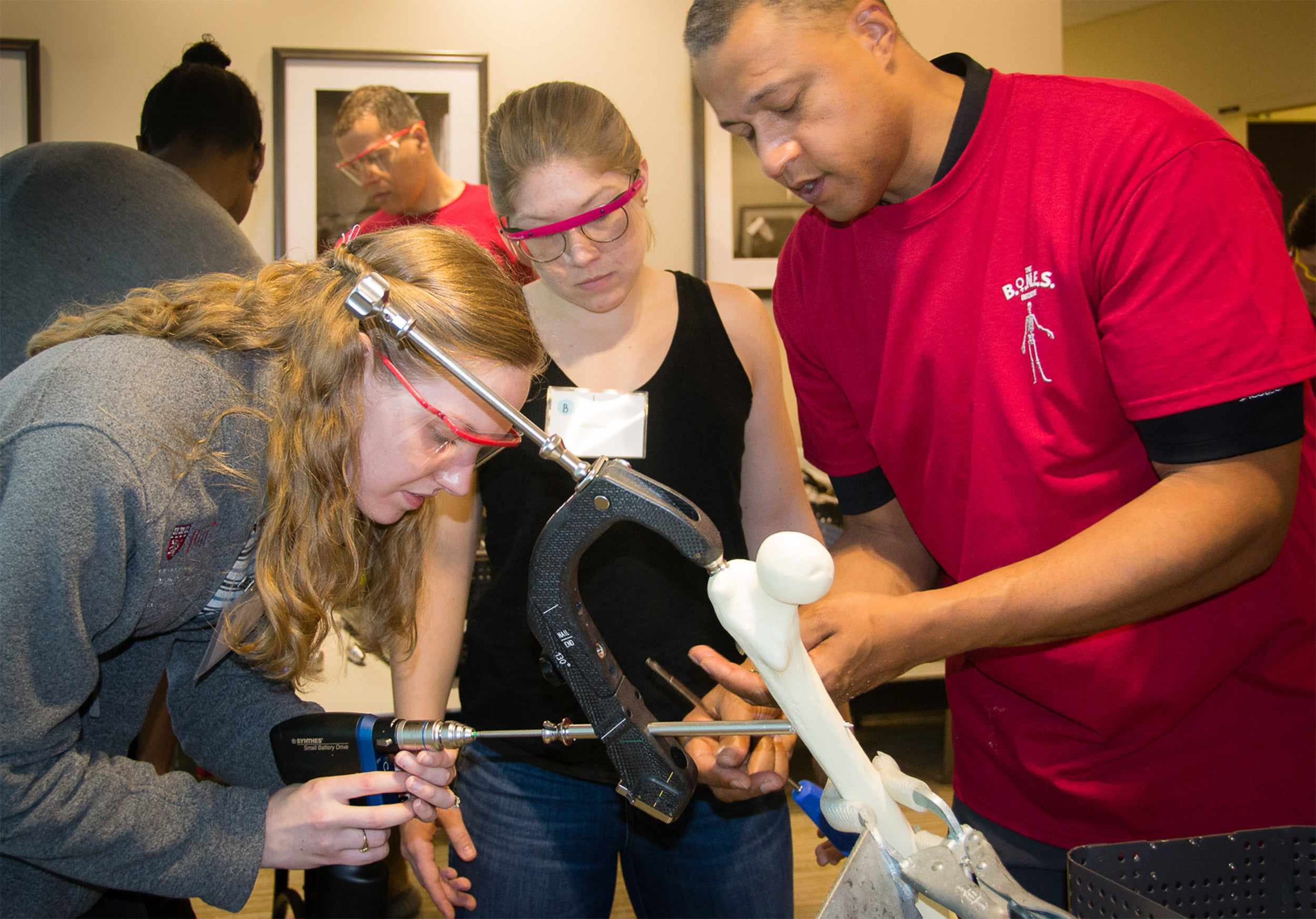 Blake Hauser (drilling) and Julia Gelissen practicing drilling and inserting intramedullary nail on sawbones model.