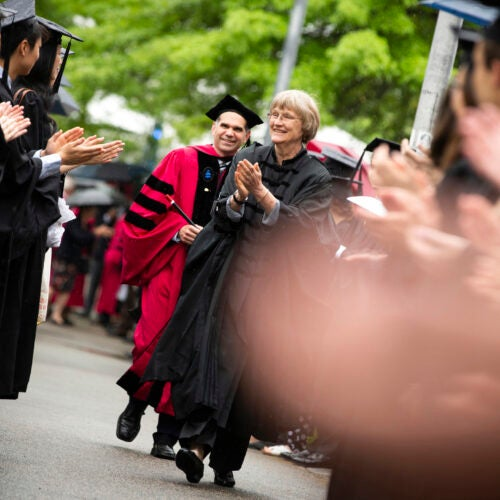 Harvard President Drew Faust (center) congratulates students outside Memorial Hall during Phi Beta Kappa Exercises.