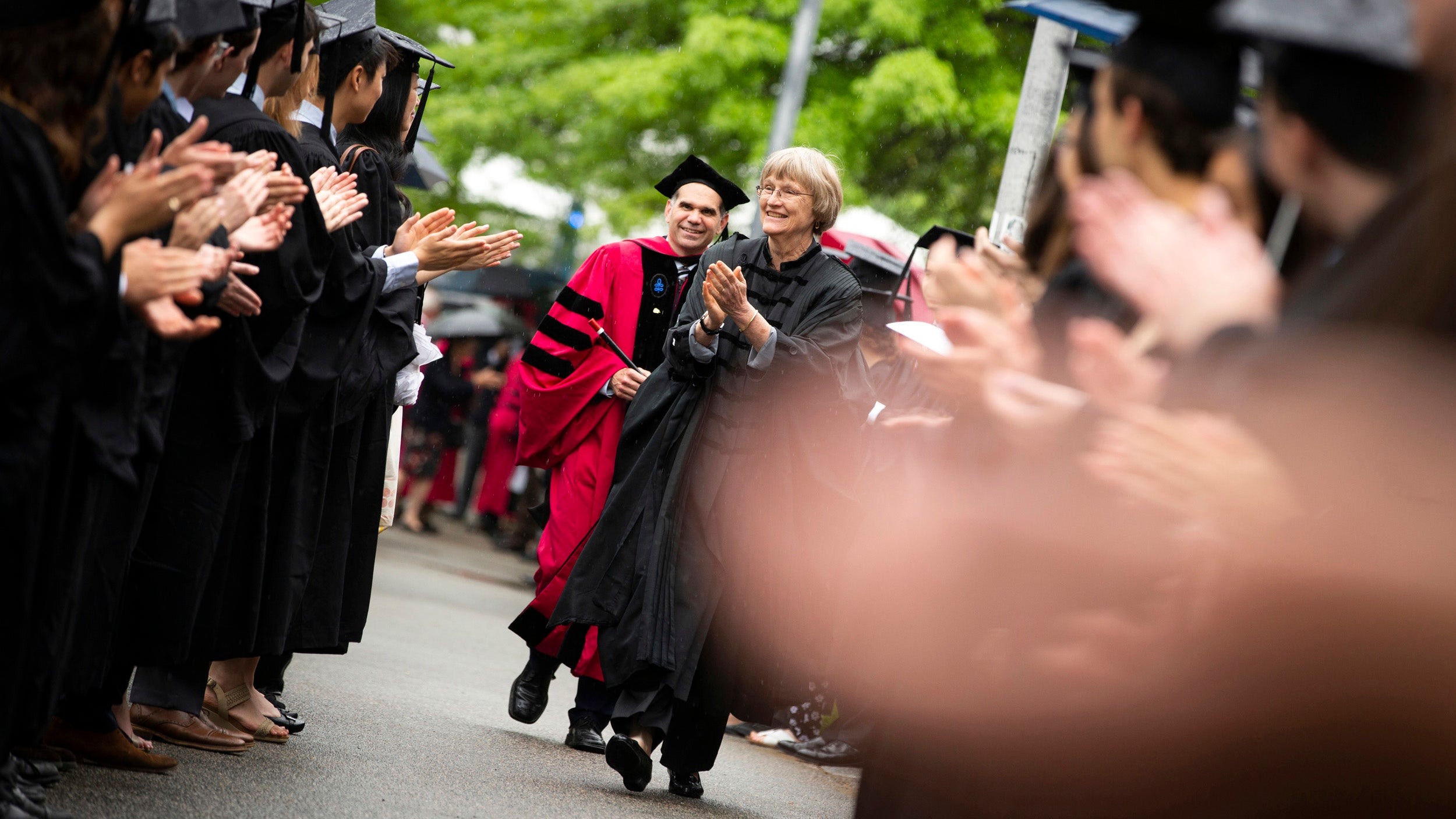 Harvard President Drew Faust (center) congratulates students outside Memorial Hall during Phi Beta Kappa Exercises.