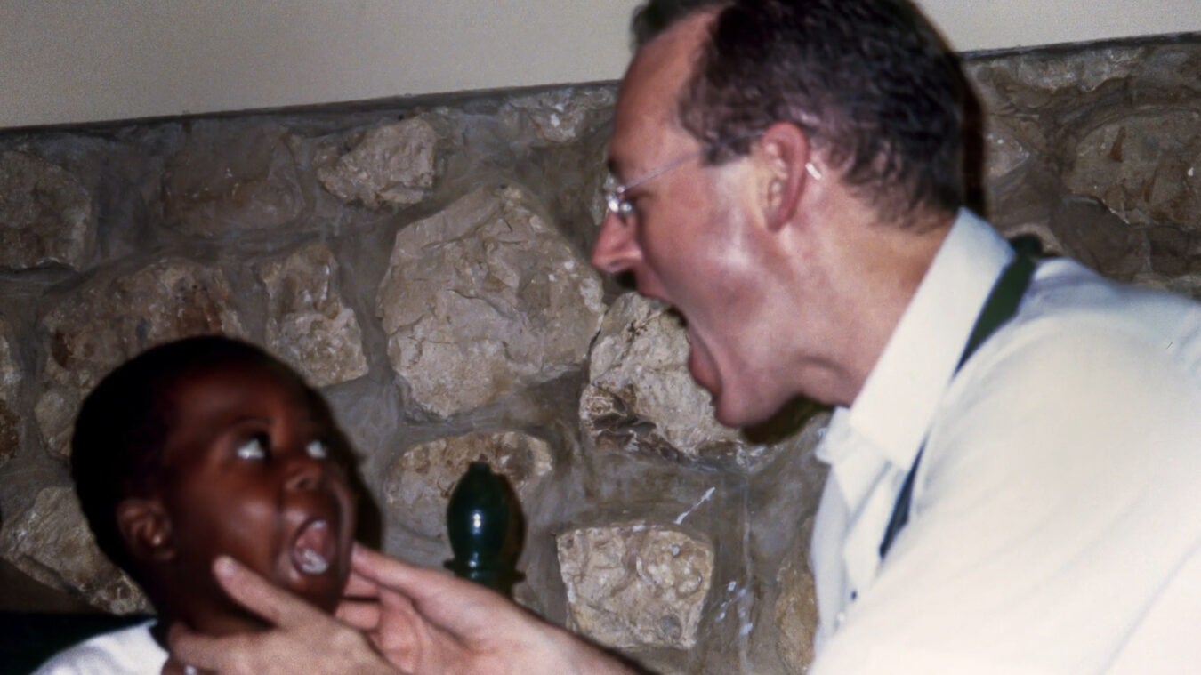 Dr. Paul Farmer examines a young patient in Haiti.