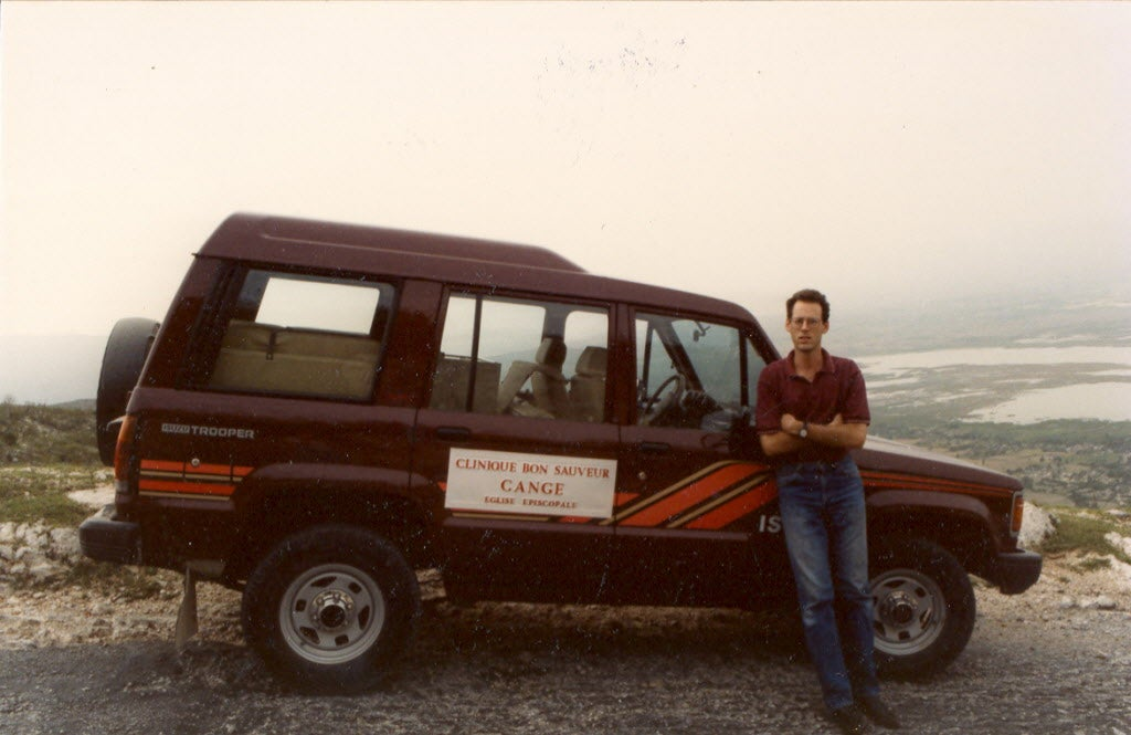 Paul Farmer in Haiti by an ambulance circa 1993.