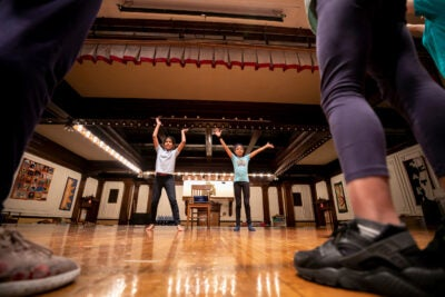 Elianni Martinez (left), and Adanna Castellano-Brown, both 9, teach a dance to their classmates and Harvard teachers Rachel Share-Sapolsky '21, Jenna Lang '21, and M.K. Howard '21.
