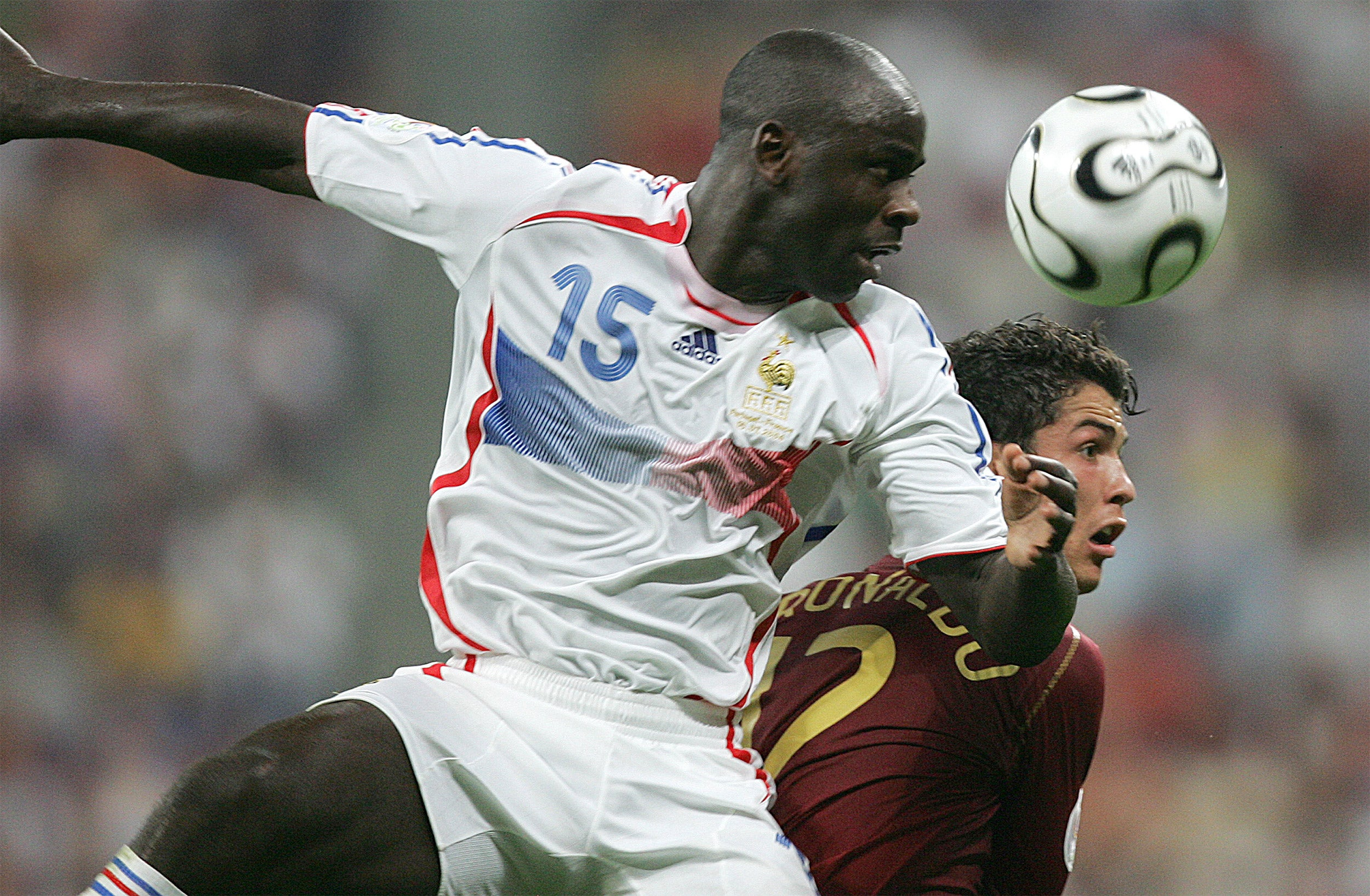 """Lilian Thuram (left), pictured battling Cristiano Ronaldo for a head ball during the 2006 World Cup, took part in """"Participation, Inclusion and Social Responsibility in Global Sports,"""" a three-day symposium on issues of racism and inclusion."""