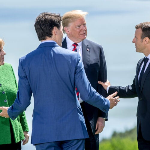 Angela Merkel, Justin Trudeau, Donald Trump, and Emmanuel Macron at the G7 summit.