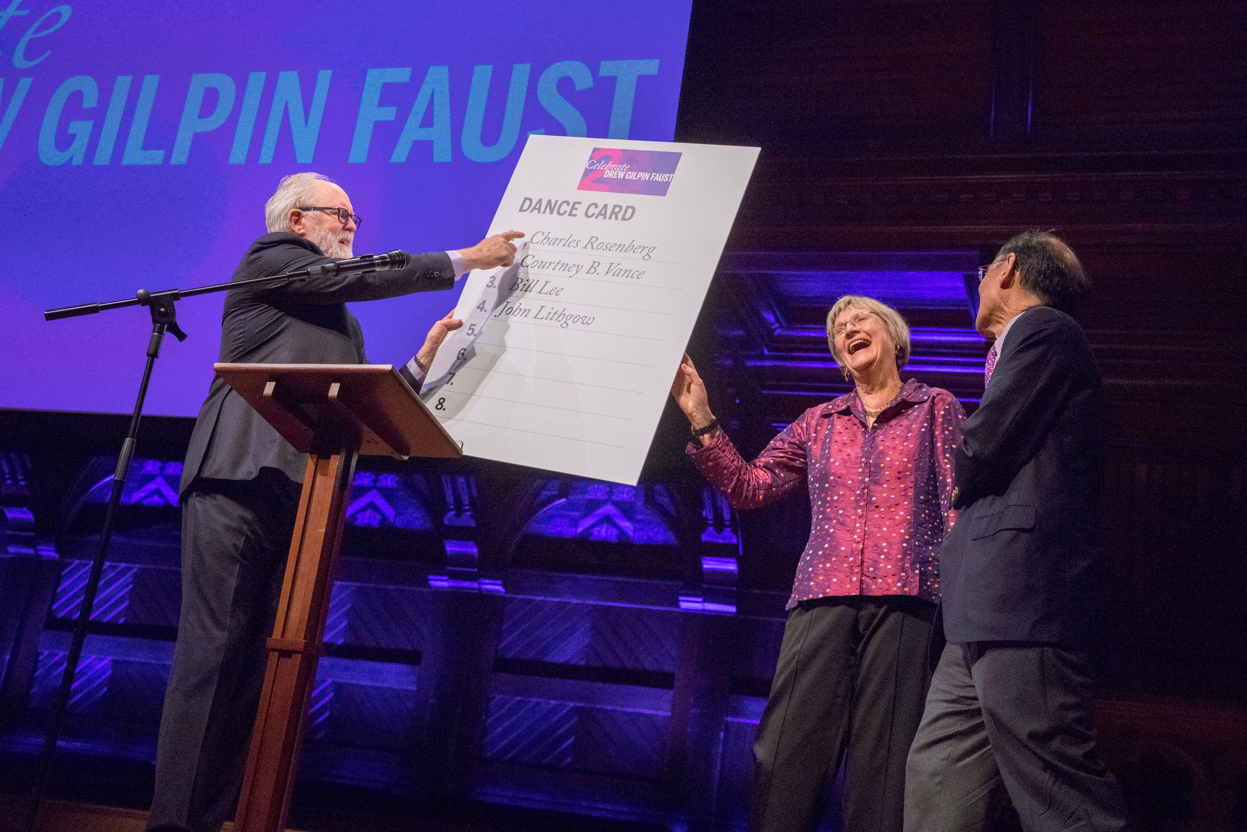 John Lithgow on stage with Drew Faust and Bill Lee.