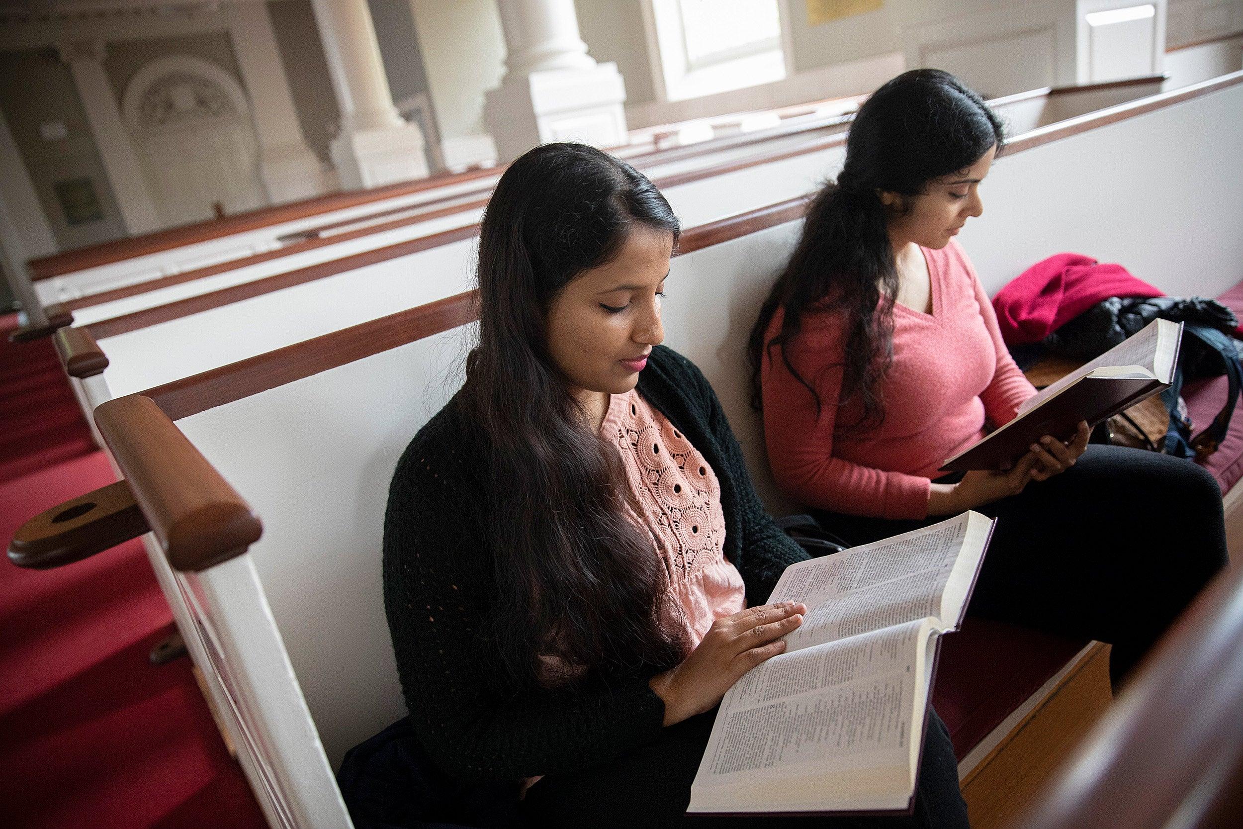 Lalitha Sindhuri (left) and Anandana Kapur read the Bible.