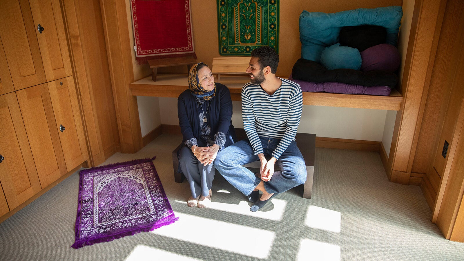 Yaseen Eldik and Sanaa Nadim pray.