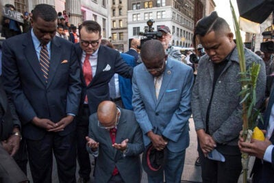 Evan Bernstein (second from left), New York regional director of the Anti-Defamation League and a Harvard Extension School graduate, participates in an interfaith prayer vigil outside Brooklyn Borough Hall after last year's mass shooting in Las Vegas.