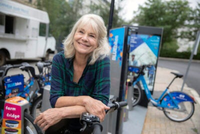 Leaning on a Blue Bike dock in front of Harvard Chan School, HSPH researcher Anne Lusk talks about how the explosion of bike-sharing is impacting overall health.