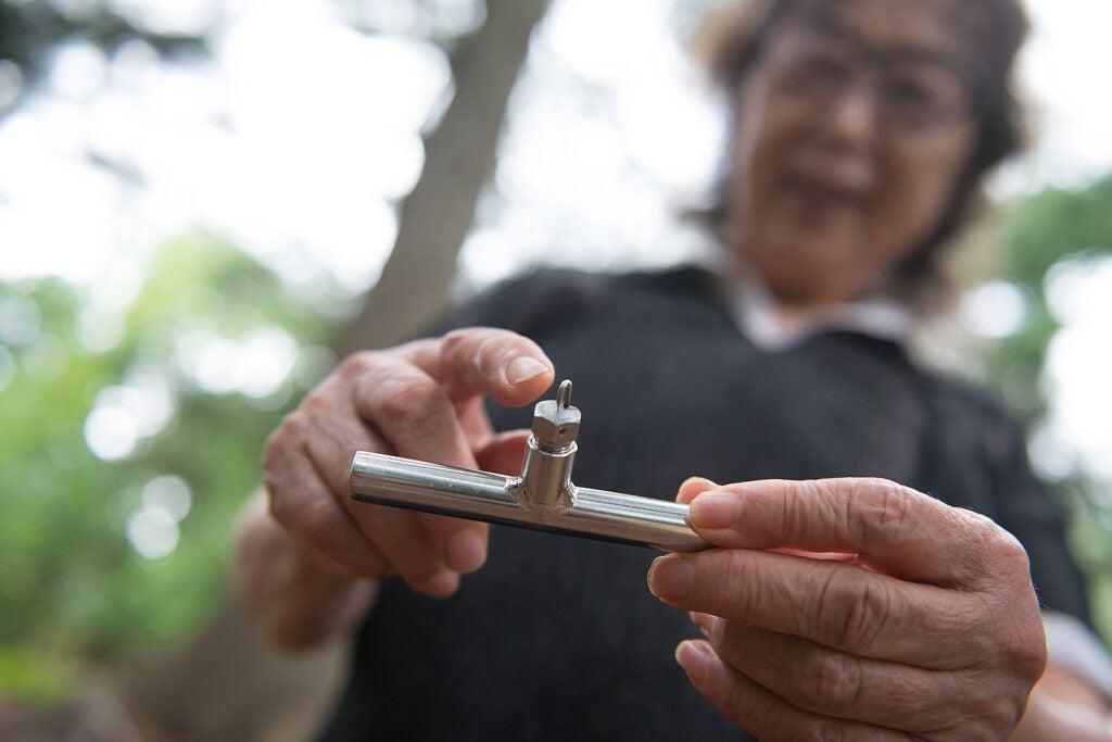Fujiko Nakaya shows nozzle she patented for fog art.