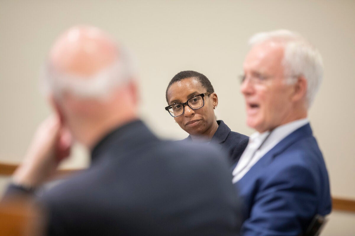 "Stephen Kosslyn (from left), Dean Claudine Gay, (center) and Sen. Bob Kerrey discuss educational practices and the science of learning during the HILT conference ""The Intentional University."""