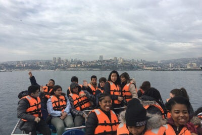 Off the coast of Valparaiso, Chile, Harvard faculty led by preceptor Adriana Gutiérrez (photographer) take a break from their exploratory visit to the University of Chile in Santiago.