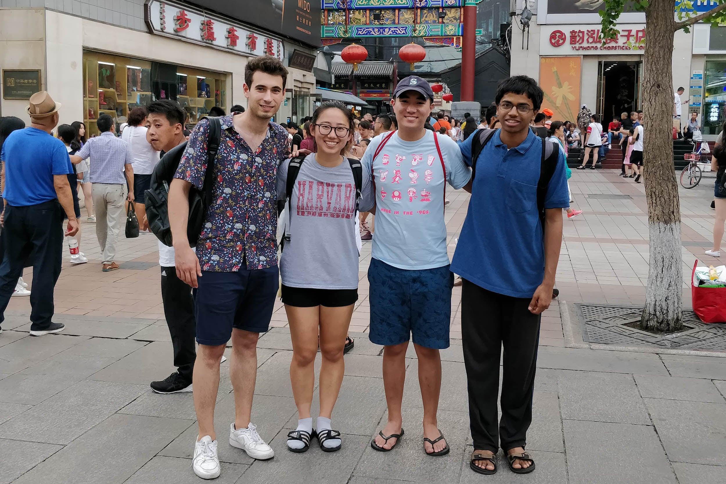 Harvard undergraduates Andrei Iliescu (from left), Irene Lu, Caleb Ren, and Adytia Mahadevan enjoy sightseeing on a cultural trip to Dong Hua Men Market.