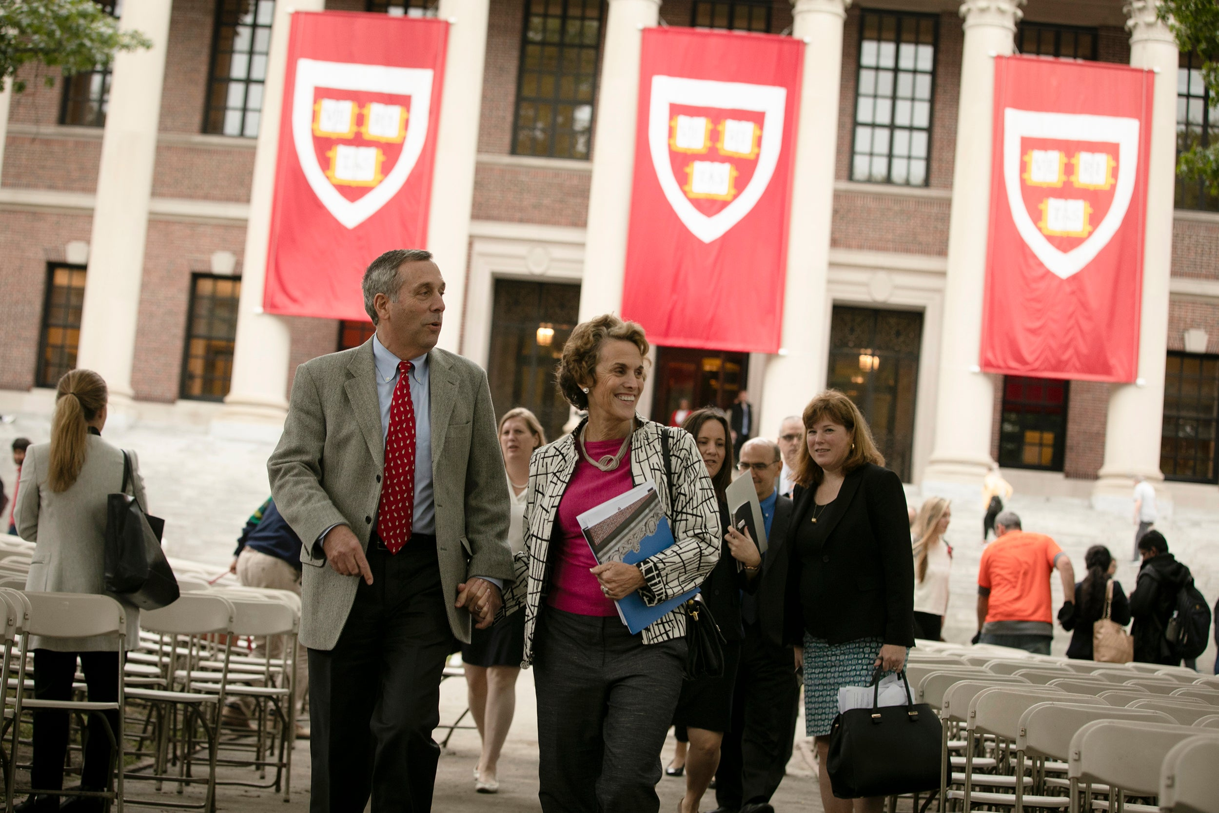 Harvard President Larry Bacow (left) and Adele Bacow walk through the schedule for his Inauguration two days before the event takes place.