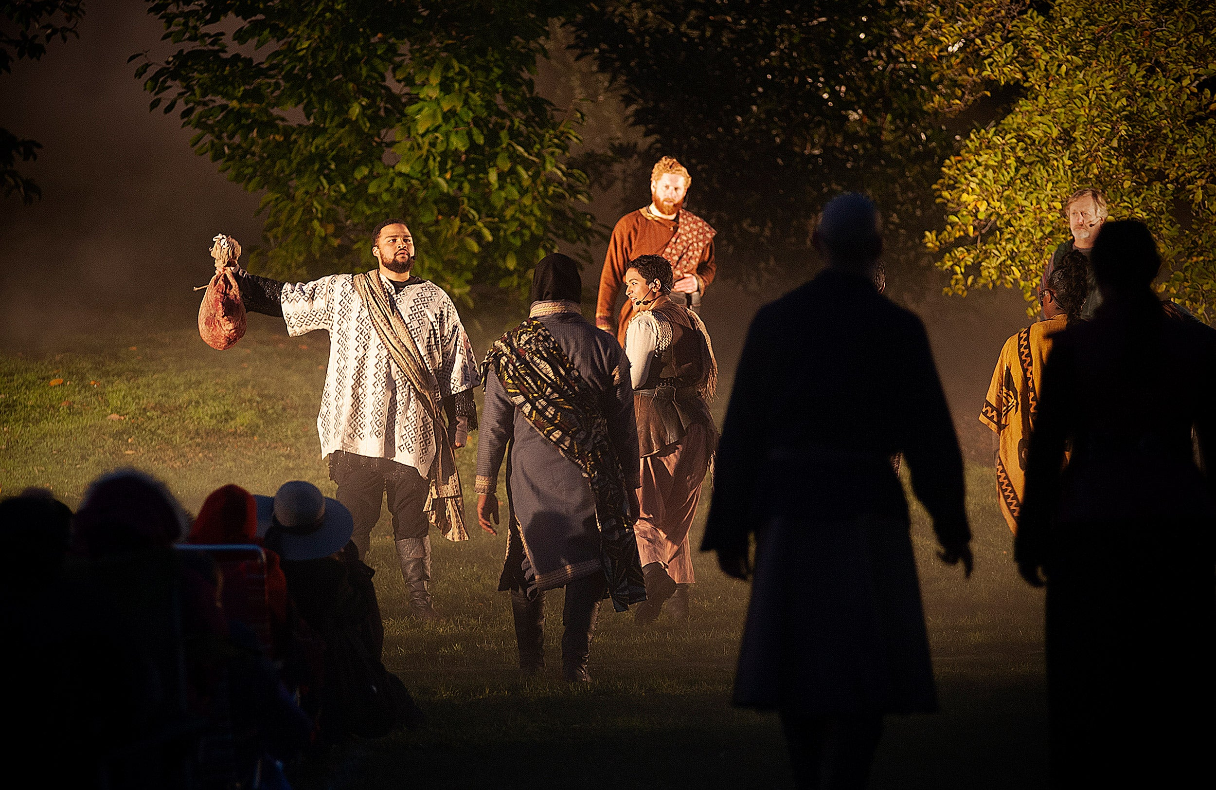 Malcolm (left), played by Kai Tshikosi, holds Macbeth's head and claims his title.