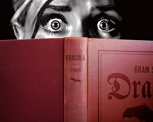 "Illustration of frightened reader peering over ""Dracula."""