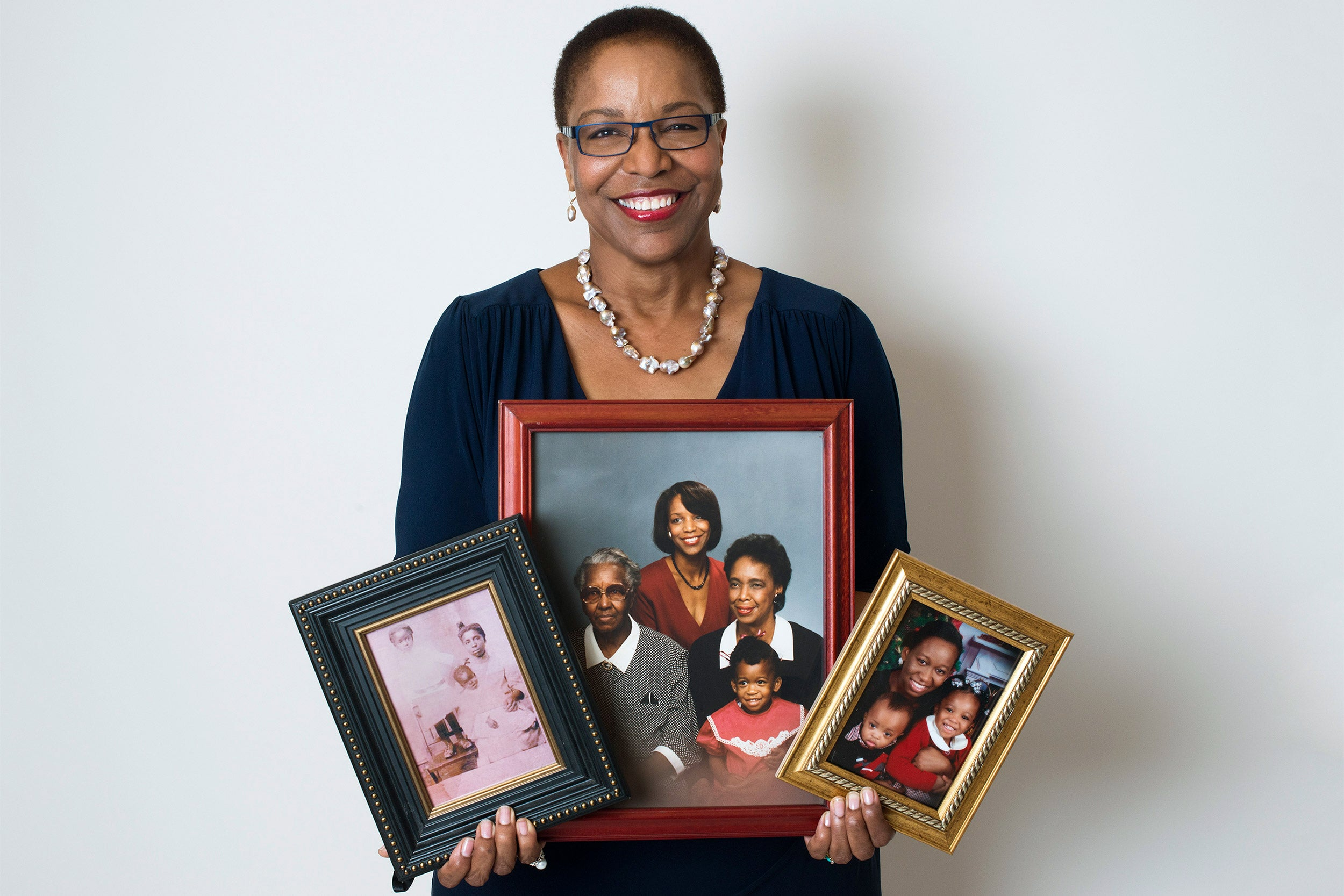 Joan Reede with photos of her family.