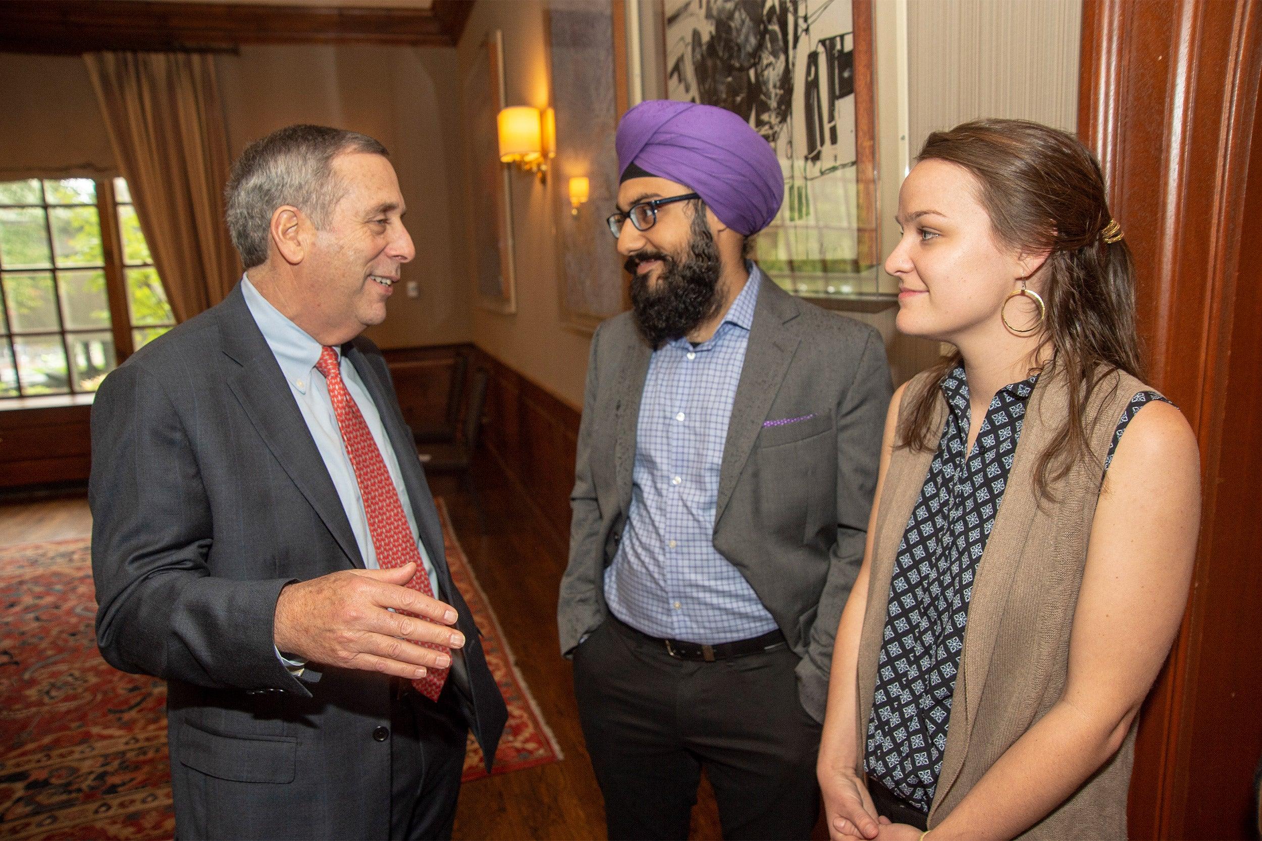 President Bacow, Harmann Singh (center), Sarah Bourland.