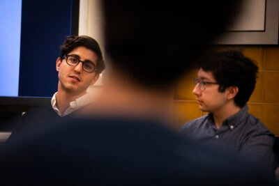 "Music & Entertainment Pathways brought Harvard graduates back to campus to discuss ways to get into the industry. Ethan Karetsky (left), Harvard Business School '20, is in content acquisition at Hulu. Nick Hornedo '19 was a summer intern on ""The Late Show with Stephen Colbert."""