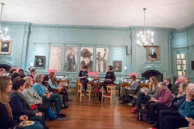 Speakers Anne Pender and Geraldine Brooks are sit flanked by audience at Houghton Library.