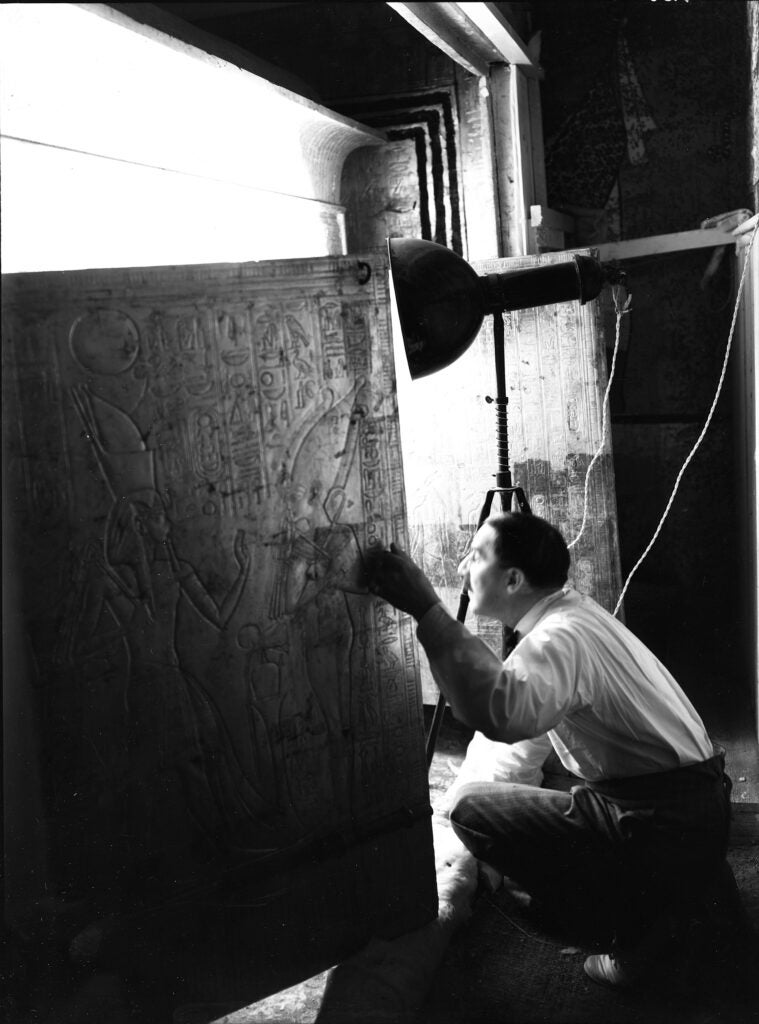 Howard Carter looking into Tutankhamun's burial shrine in January, 1924.