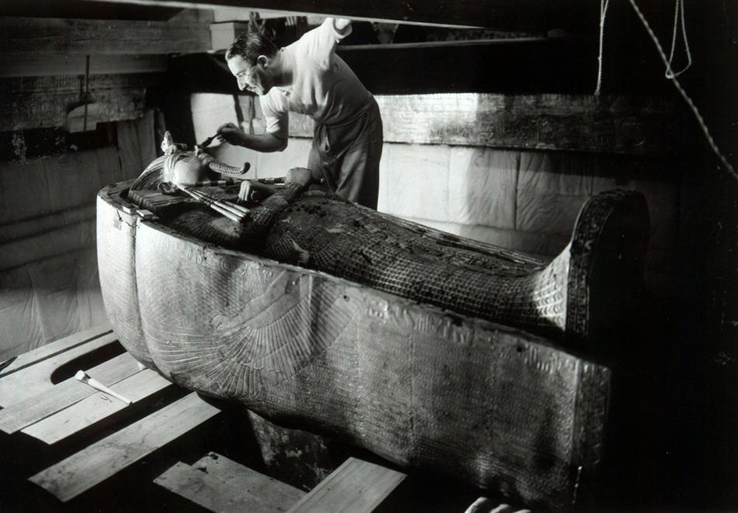 Howard Carter examines King Tut's coffin in January, 1924.