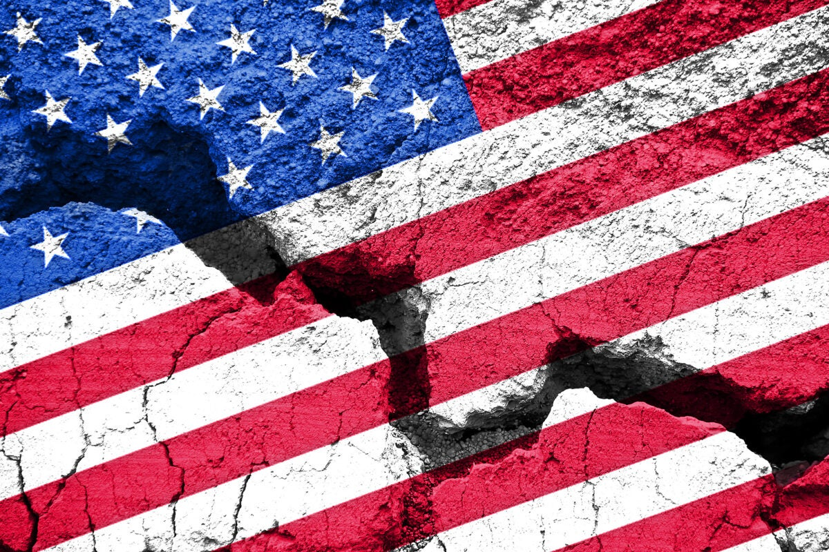 U.S. flag on cracked background.