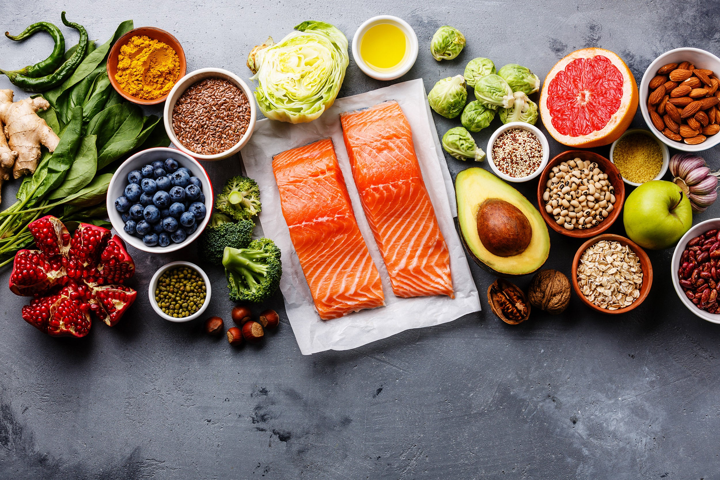 Healthy food clean eating selection: fish, fruit, vegetable, seeds, superfood, cereals, leaf vegetable