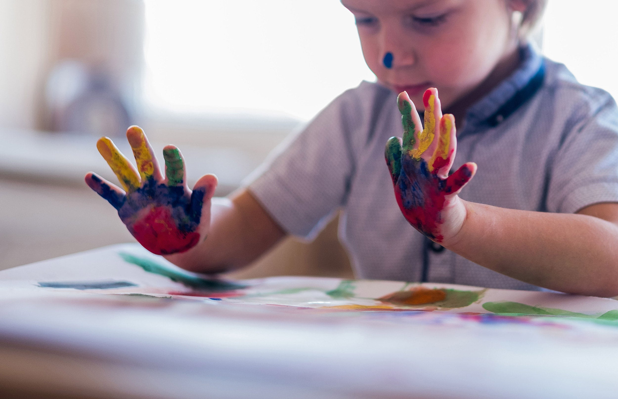 Little boy is doing handprint