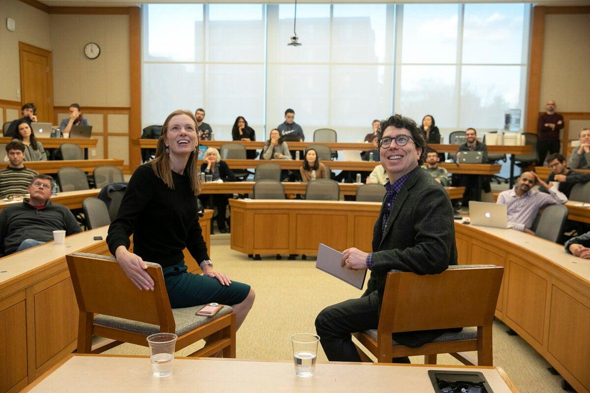 Monika Bickert and Jonathan Zittrain looking up at a screen