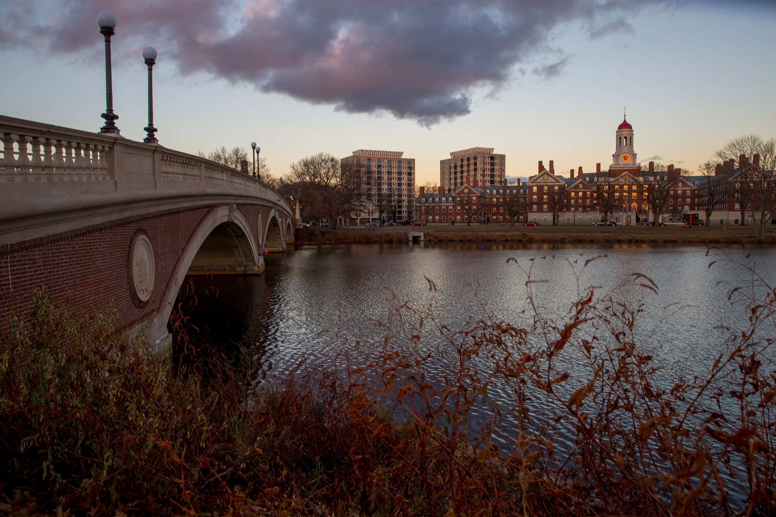 Views at dusk of the Charles River, the Weeks Footbridge,