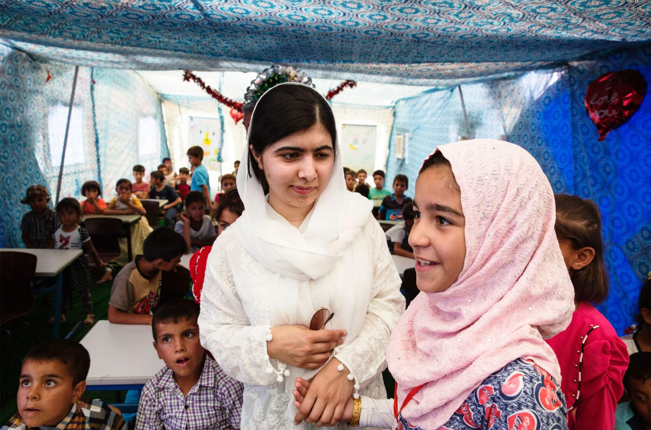 Malala Yousafzai in a classroom full of kids