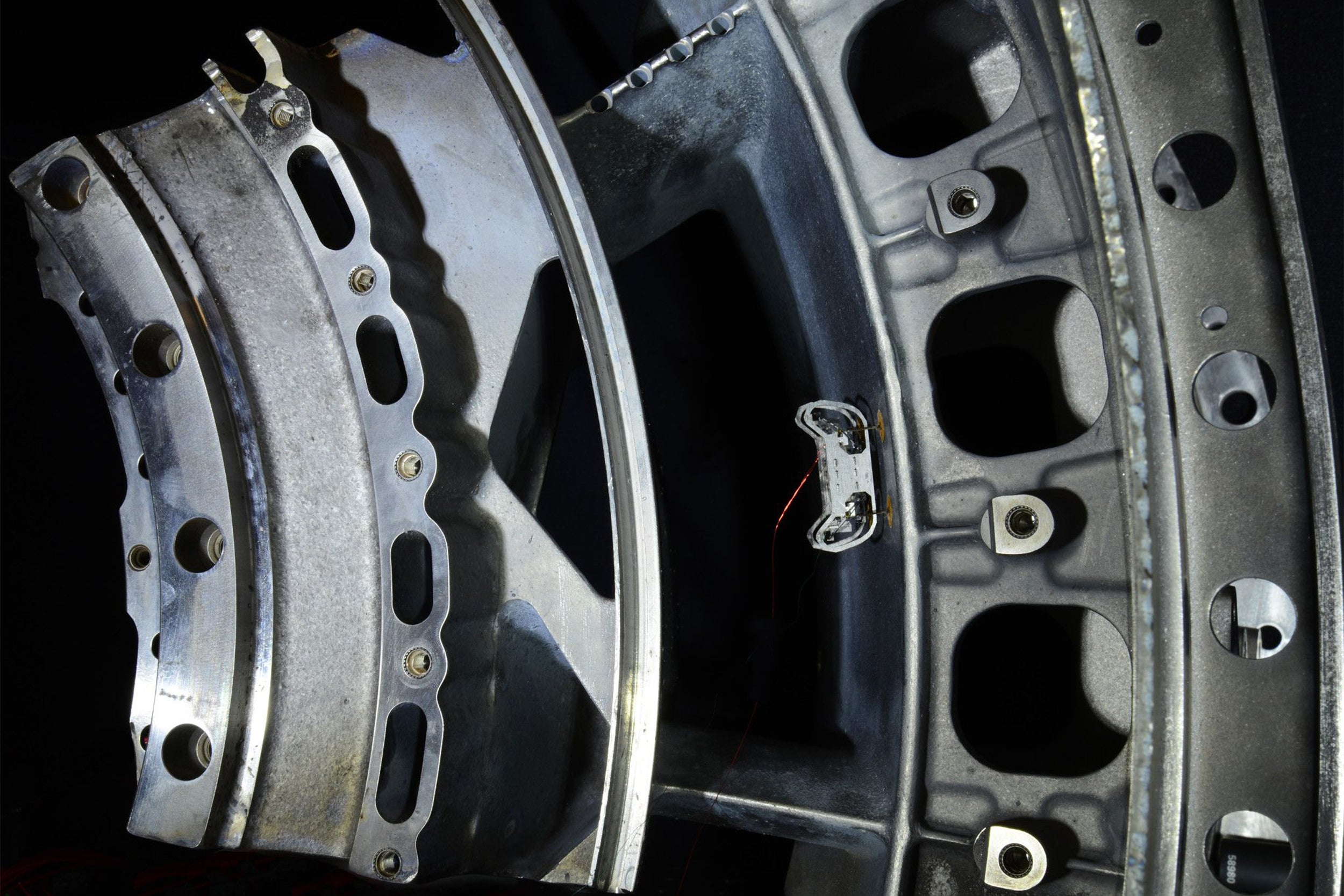 HAMR-E uses electroadhesive pads on its feet and a special gait pattern to climb vertical, inverted, and curved surfaces, like the inside of this jet engine.